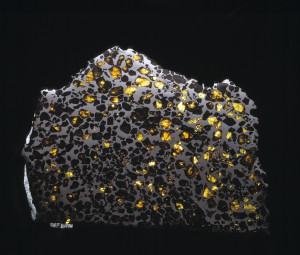 Image of the Esquel Meteorite. This meteorite consists of gem-quality olivine embedded within an Fe-Ni matrix. © The Trustees of the Natural History Museum, London